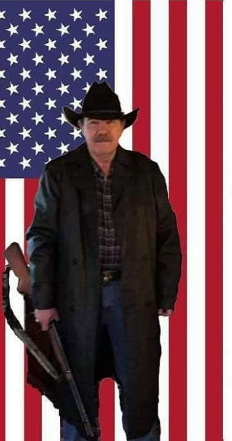 Name:  Cowboy with rifle and flag.jpg Views: 78 Size:  74.4 KB