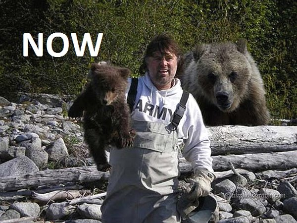 Name:  now-man-holding-bear-cub-with-mama-bear-in-the-background.jpg