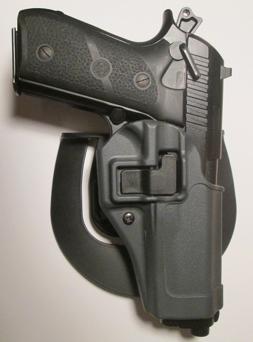 Name:  PT92 in Blackhawk Serpa Holster.JPG